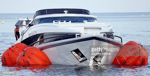 """Man works on the yacht """"Vals II"""" after the vessel sank on October 3 in the bay of Saint-Jean-Cap-Ferrat, southern France. An enquiry was opened after..."""