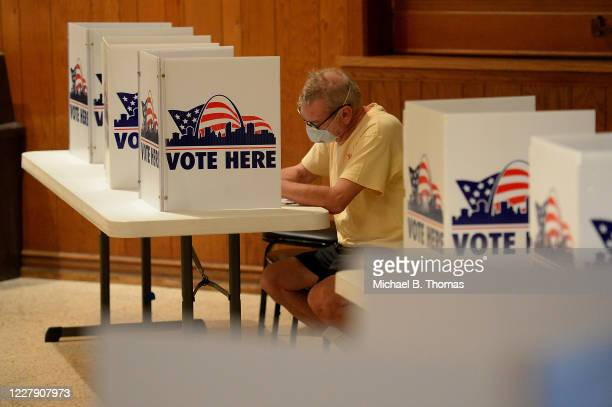 Man works to complete his ballot in Missouri's primary election on August 4, 2020 at Gambrinus Hall in St Louis, Missouri. Voters will see a host of...
