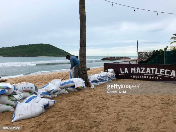 A man works trying to protect a restaurant from Hurricane Willa before its arival in Mazatlan Sinaloa state Mexico on October 22 2018 Hurricane Willa...