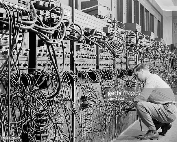 A man works with the first general purpose computer called the Electronic Numerical Integrator and Computer at the US Army's Aberdeen Proving Ground...