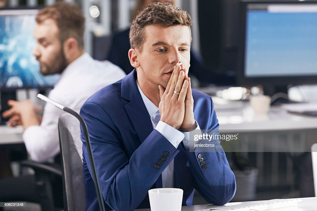 Man worried at work. Corporate business : Stock Photo
