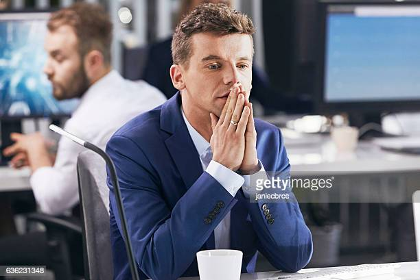 Man worried at work. Corporate business