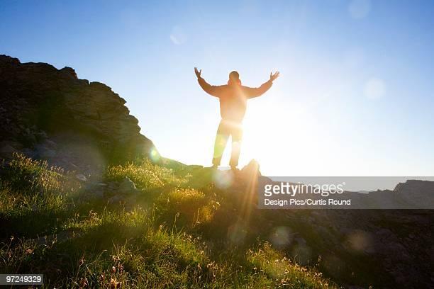 Man worshipping in nature