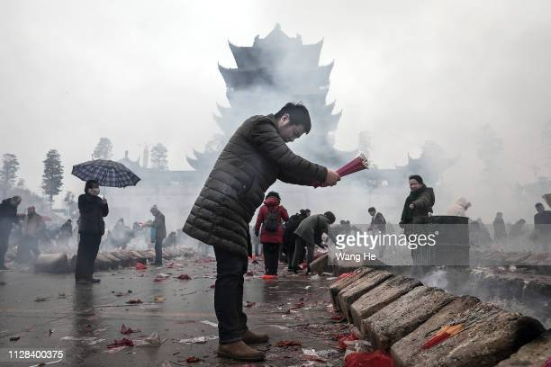 OUT) A man worships the God of Fortune at the Guiyuan Temple on February 09 2019 in Wuhan Hubei province China The fifth day in the lunar new year is...