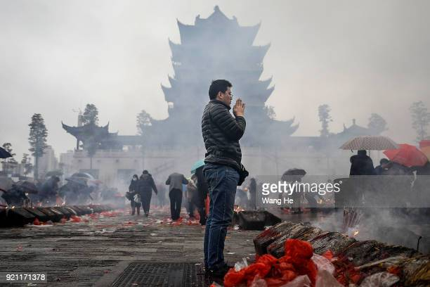A man worships the God of Fortune at the Guiyuan Temple on February 20 2018 in Wuhan Hubei province China The fifth day in the lunar new year is...