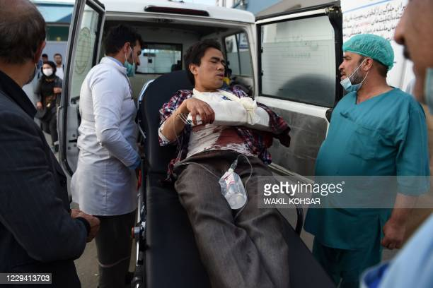 Man, wounded after gunmen stormed Kabul university, arrives in an ambulance to Isteqlal Hospital in Kabul on November 2, 2020. - Gunmen stormed Kabul...