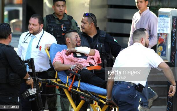 Man wounded during an attack against Secretary of Labour and ex-prosecutor of Jalisco Luis Carlos Najera is assisted in downtown Guadalajara, Jalisco...