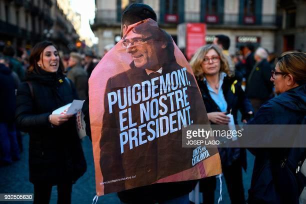 TOPSHOT A man wrapped in a banner reading 'Puigdemont our president' takes part in a demonstration called by Omnium Cultural to demand a Catalan...