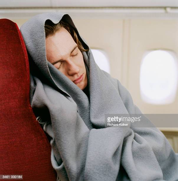 Man Wrapped in Blanket