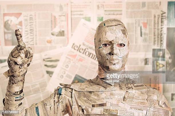 Man wrapped in newspaper