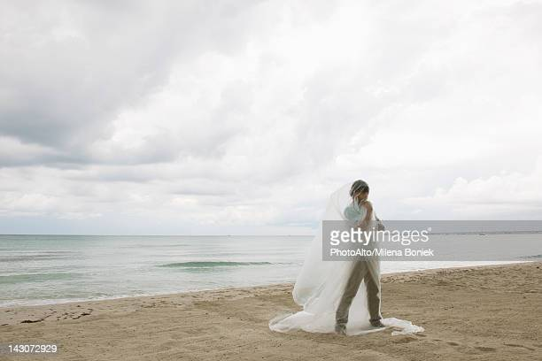man wrapped in plastic on beach - man wrapped in plastic stock pictures, royalty-free photos & images