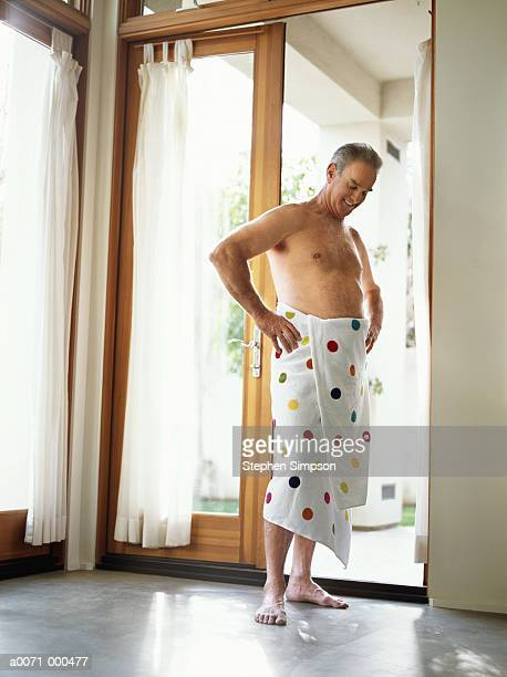 man wrapped in towel - wrapped in a towel stock pictures, royalty-free photos & images
