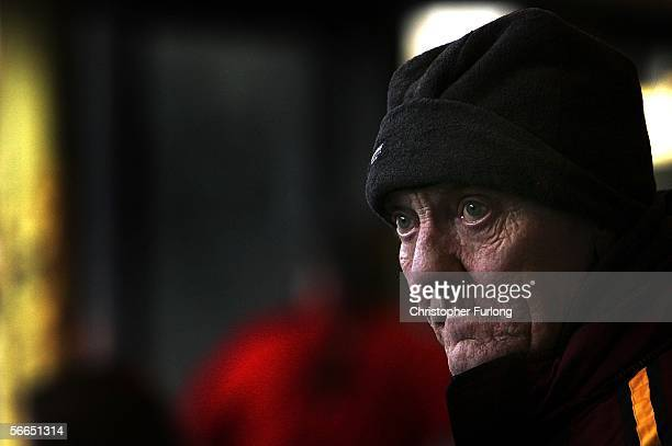 Man wrapped up against the bitter cold waits for a bus home at Preston bus station on January 23, 2006 in Preston, England. Scientists from Cardiff...