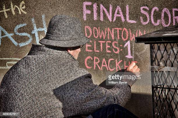 CONTENT] A man writes a message of protest on a wall with chalk at Nathan Phillips Square for Mayor Rob Ford