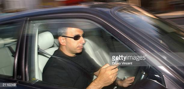 A man writes a text message on his mobile phone whilst driving in traffic on June 24 2003 in London England The government has announced plans for a...