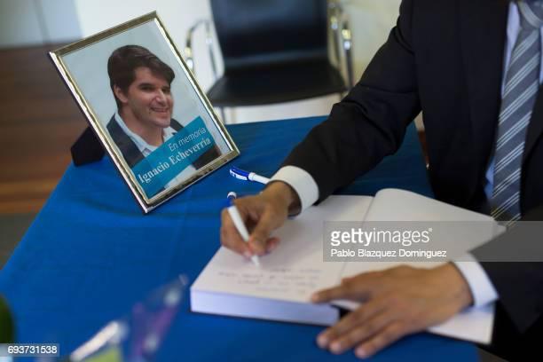 A man writes in a condolence book next to a picture of Ignacio Echevarria ahead of a vigil to honour London Bridge terror attack hero Ignacio...