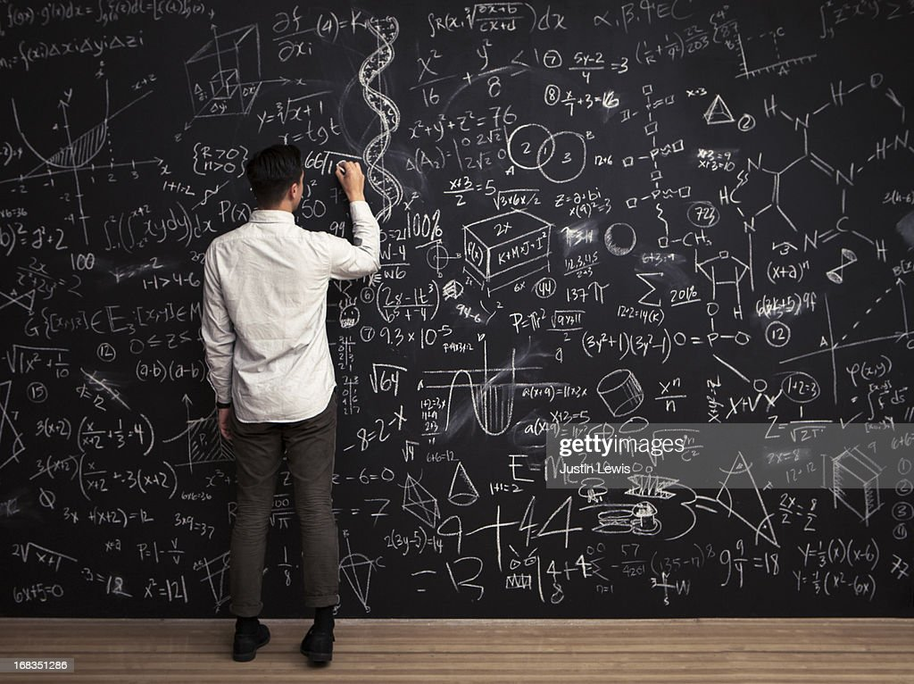 Man writes mathematical equations on chalkboard : Stock Photo