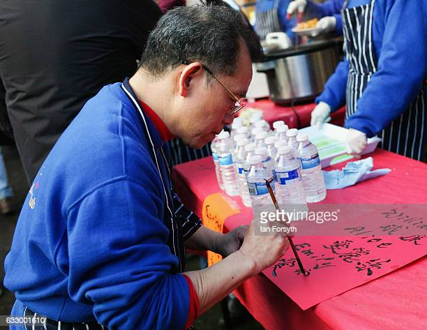A man writes names in Chinese writing during the Chinese New Year celebrations to mark The Year of the Rooster on January 29 2017 in Newcastle Upon...