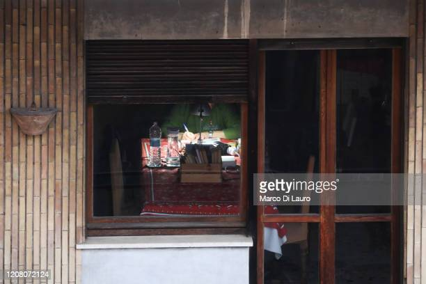 A man writes sitting at his home table on March 22 2020 in Rome Italy As Italy extends its nationwide lockdown to control the spread of COVID19 its...