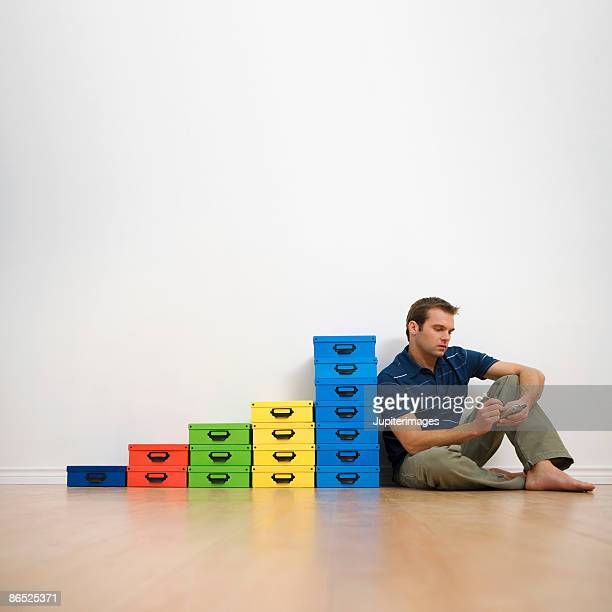 man writing on pda with boxes - color coded stock pictures, royalty-free photos & images