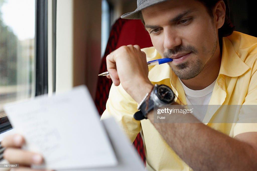 Man Writing Postcards : Stock Photo