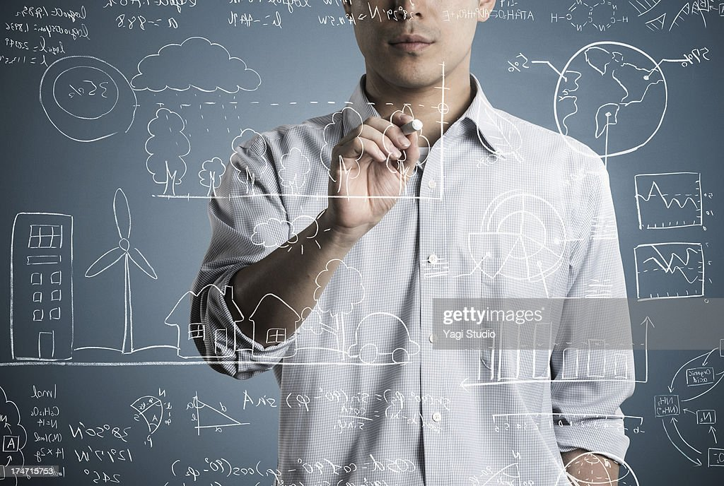 Man writting a formula and picture in chalk : Stock Photo