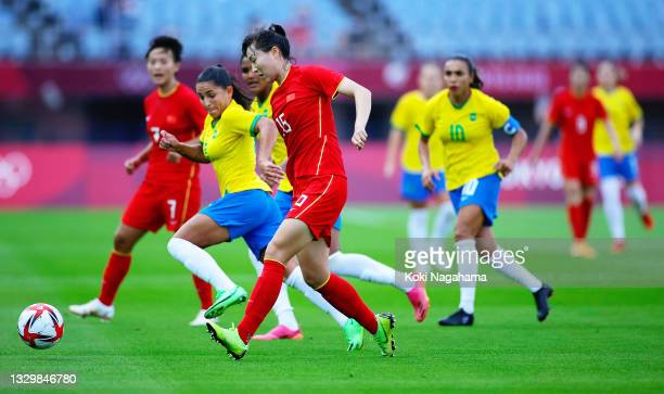 Man Yang of Team China passes the ball during the Women's First Round Group F match between China and Brazil during the Tokyo 2020 Olympic Games at...