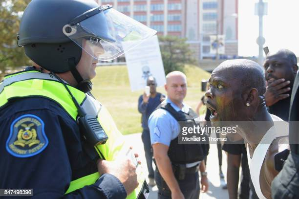 A man yells at a law enforcement officer during a protest action following a not guilty verdict on September 15 2017 in St Louis Missouri Protests...