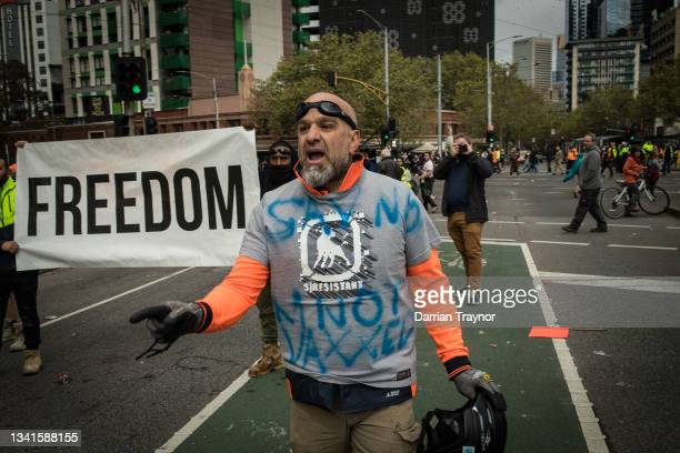 Man yells at Police on Elizabeth Street near the CFMEU office on September 21, 2021 in Melbourne, Australia. Protests started outside the...