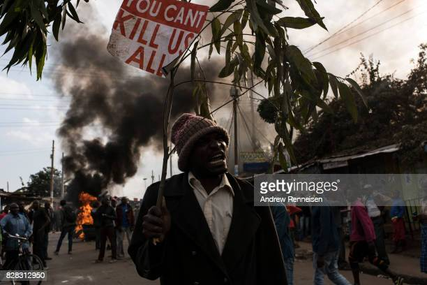 A man yells during protest in Kibera Kenya's biggest slum on August 9 2017 in Nairobi Kenya The protest started after police allegedly killed two...