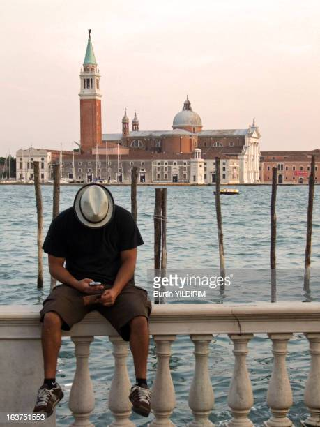 CONTENT] man young teen teenage cell phone mobile venice italy travel europe holliday church hat water