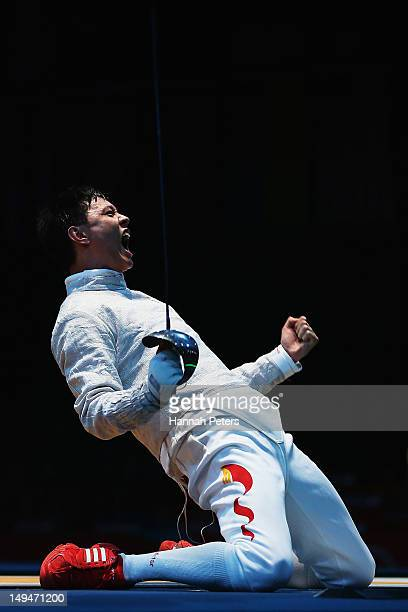 Man Zhong of China celebrates after winning the Men's Sabre Individual Fencing round of 32 match against Junghwan Kim of Korea on Day 2 of the London...