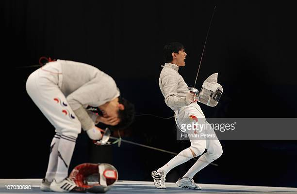 Man Zhong of China celebrates winning the gold medal in the Men's Team Sabre Final against Bon Gil Gu of South Korea at Guangda Gymnasium during day...
