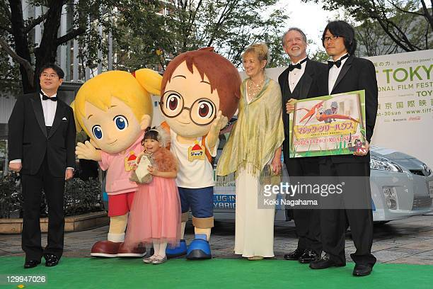 Mana Ashida poses on the green carpet during the Tokyo International Film Festival Opening Ceremony at Roppongi Hills on October 22, 2011 in Tokyo,...