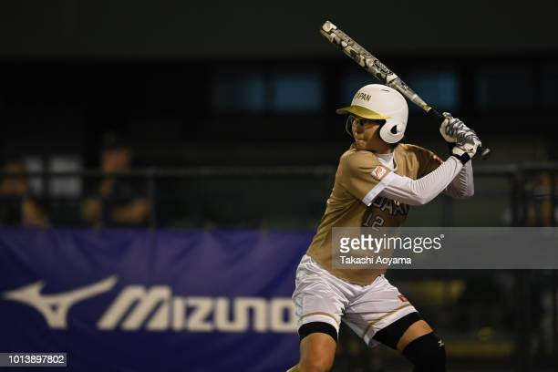 Mana Atsumi of Japan bats against Australia during their Preliminary Round match at Akitsu Stadium on day eight of the WBSC Women's Softball World...