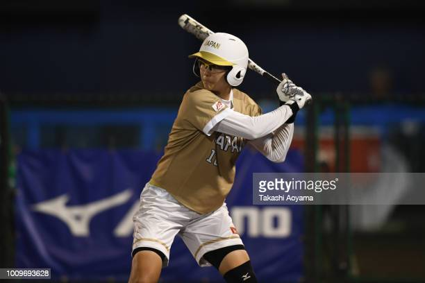 Mana Atsumi of Japan bats against Italy during the Preliminary Round match on day one of the WBSC Women's Softball World Championship on August 2...