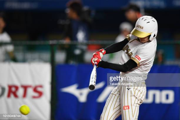 Mana Atsumi of Japan hits a single in the fifth inning against United States during their Playoff Round match at ZOZO Marine Stadium on day ten of...
