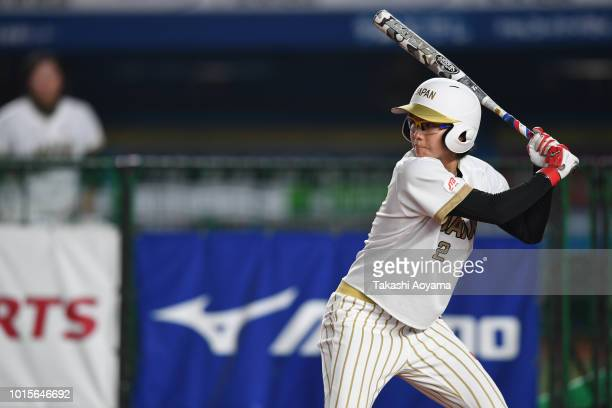 Mana Atsumi of Japan hits a single in the second inning against United States during their World Championship Final match at ZOZO Marine Stadium on...