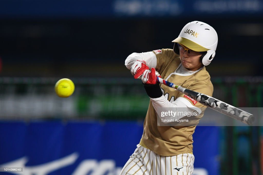Mana Atsumi #12 of Japan hits an RBI single in the first inning against Puerto Rico during the Playoff Round at ZOZO Marine Stadium on day nine of the WBSC Women's Softball World Championship on August 10, 2018 in Chiba, Japan.