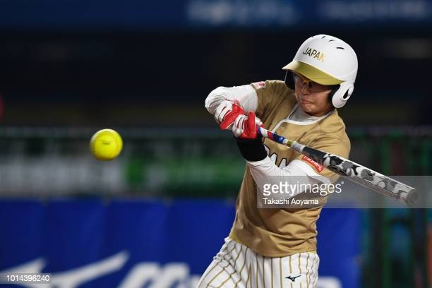 Mana Atsumi of Japan hits an RBI single in the first inning against Puerto Rico during the Playoff Round at ZOZO Marine Stadium on day nine of the...