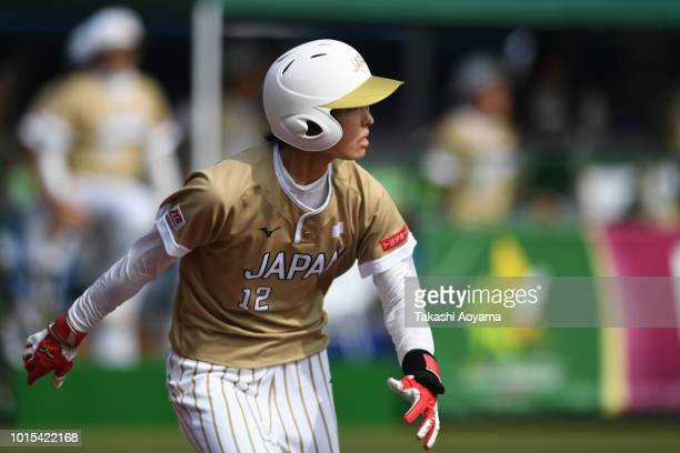 Mana Atsumi of Japan hits triple in the third inning against Canada during their Bronze Medal Game at ZOZO Marine Stadium on day eleven of the WBSC...