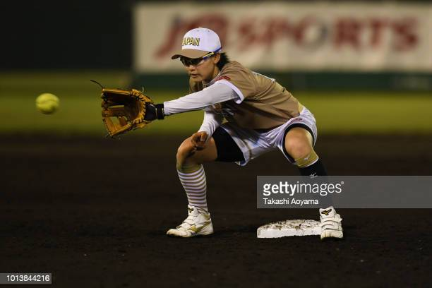 Mana Atsumi of Japan in action against Australia during their Preliminary Round match at Akitsu Stadium on day eight of the WBSC Women's Softball...