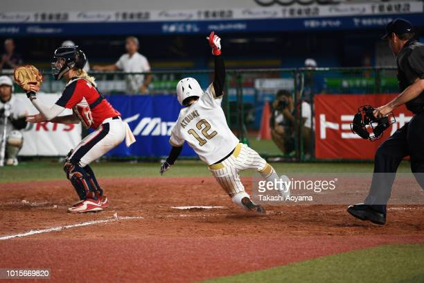 Mana Atsumi of Japan scores in the eighth inning against United States during their World Championship Final match at ZOZO Marine Stadium on day...