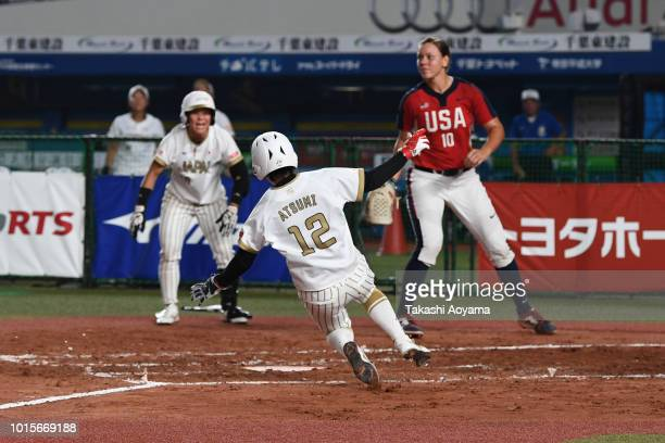 Mana Atsumi of Japan scores in the second inning against United States during their World Championship Final match at ZOZO Marine Stadium on day...