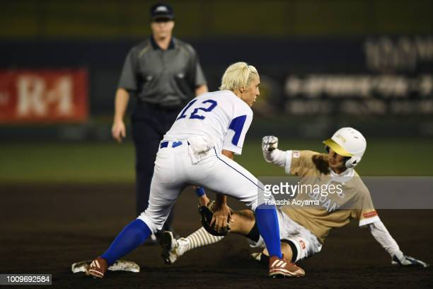 Mana Atsumi of Japan steals the second base against Amanda Lynn Fama of Italy during the fourth inning on day one of the WBSC Women's Softball World...