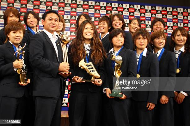 Mana Iwabuchi Aya Miyama Japan team coach Norio Sasaki Homare Sawa Shinobu Ohno Asuna Tanaka Nahomi Kawasumi and Aya Sameshima attend a press...