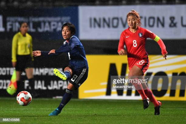 Mana Iwabuchi of Japan and Cho Sohyun of South Korea compete for the ball during the EAFF E1 Women's Football Championship between Japan and South...