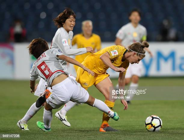 Mana Iwabuchi of Japan and Elise KellondKnight of Australia battle for the ball during the AFC Women's Asian Cup final between Japan and Australia at...