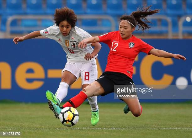 Mana Iwabuchi of Japan and Jang Selgi of Korea battle for the ball during the AFC Women's Asian Cup Group B match between South Korea and Japan at...