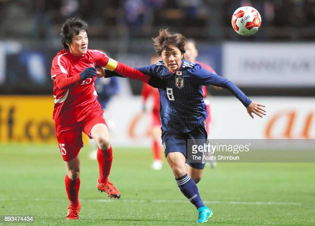 Mana Iwabuchi of Japan and Kim Nam Hui of North Korea compete for the ball during the EAFF E1 Women's Football Championship between Japan and North...